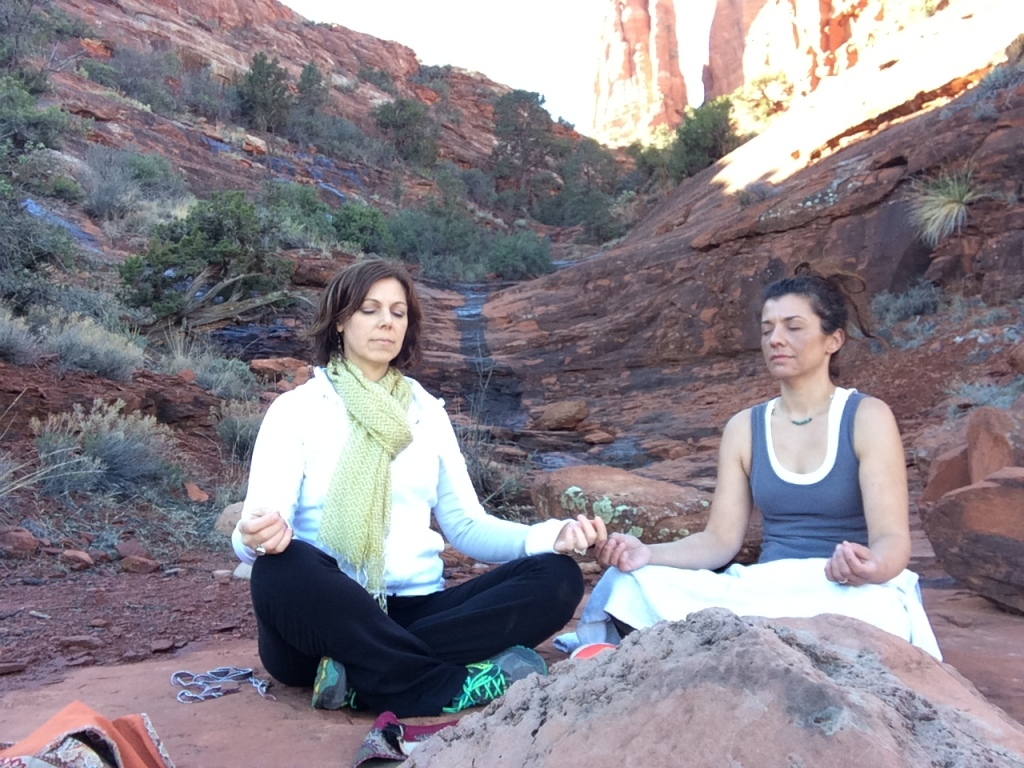 Meditating with my friend Angie in Sedona by Cathedral Rock